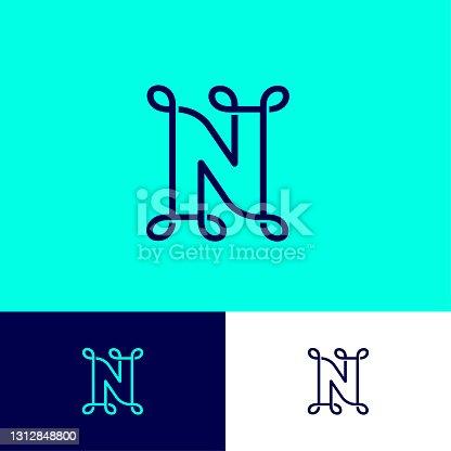 istock N letter. N monogram, letter wits loops. 1312848800