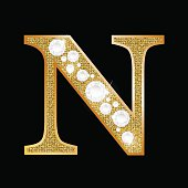 Letter N of gold and diamond