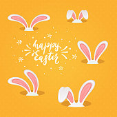 White rabbit heads with pink ears in the hole and lettering Happy Easter on a orange background, illustration.