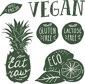 Lettering on fruits and vegetables. Dark color and white illustrations. 2 layers vector set.