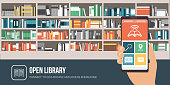 Library app on a smartphone and bookshelves on the background with colorful books