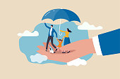 istock Life insurance, family protection to assure members will be financially supported and risk cover concept, lovely family with husband, wife and kids in supporting hand with umbrella cover protection. 1297366388