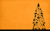 Horizontal vector illustration with brown coloured vintage paper backgrounds with a christmas tree to the right in the frame. The Xmas tree is three layered modular and is composed of small Christmas ornaments, X'Mas trees, swirls, snowflakes, stars, balls, candy cane. Apt to use as Xmas and New Year greeting cards, wallpapers or gift wrapping paper sheets.