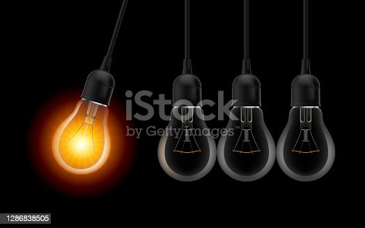 Innovation Idea Concepts Glowing Light Bulb. Light Bulbs in Row with Single one in Motion and Shinning, Isolated on Black Background