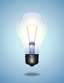 A clear Light Bulb is in midair against a gradient Blue Background. Vector-Based Illustration, No gradient mesh and 3D program used. Download Includes: High Resolution JPG, Illustrator 0.8 EPS, CS2 AI & EPS.