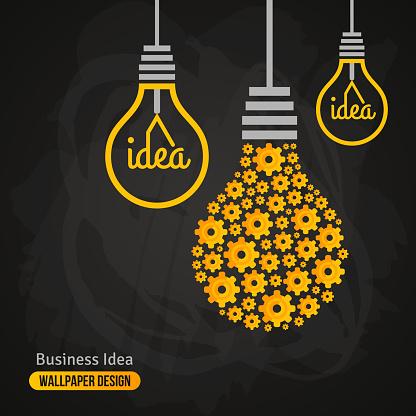 Light Bulb with Gears Pattern on Blackboard Background.