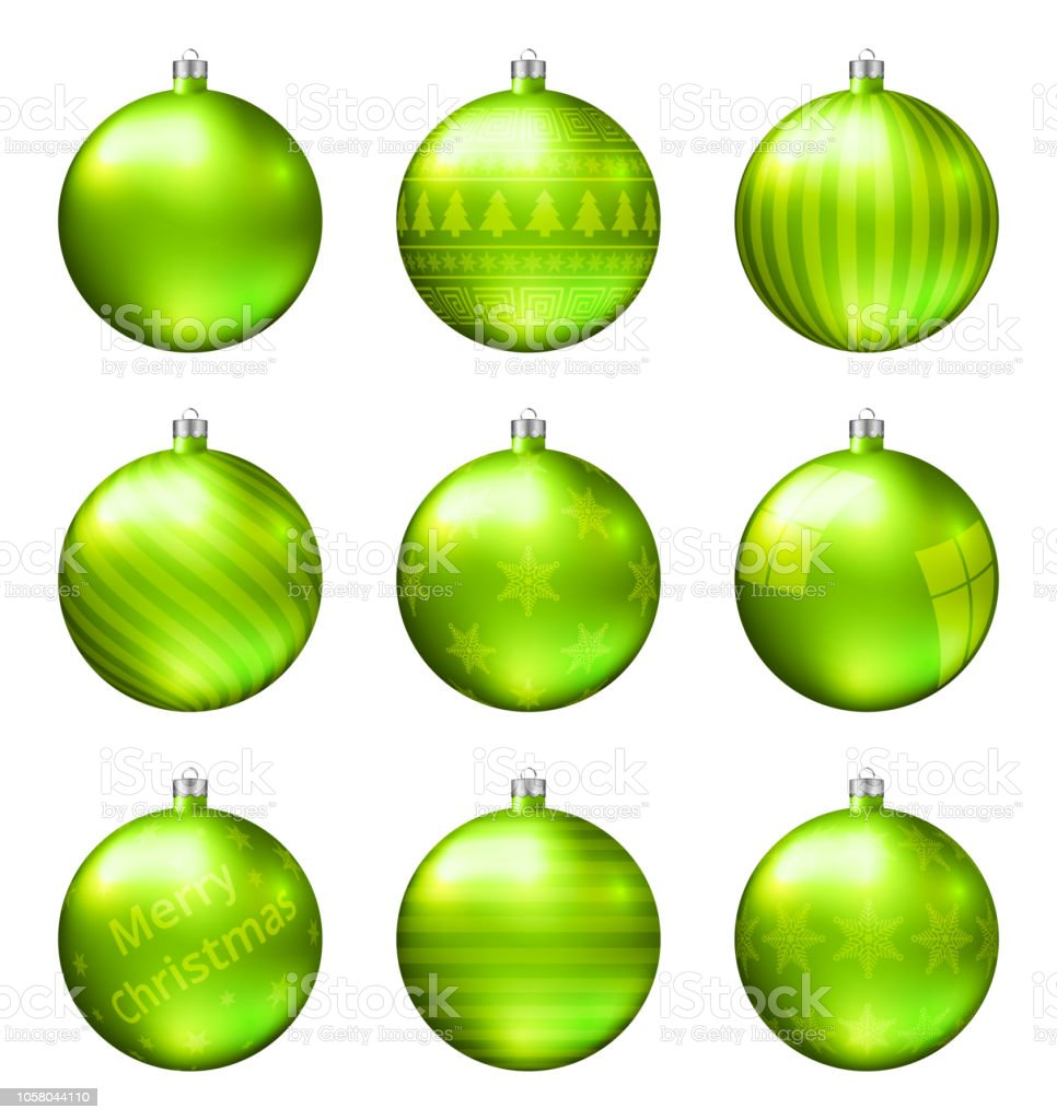 Light green christmas balls isolated on white background....