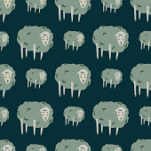 istock Light green colored sheep ornament seamless village pattern. Cute cartoon animals silhouettes on navy blue background. 1279436846