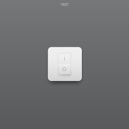 Light switch on gray background.