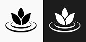 Lily Flower Icon on Black and White Vector Backgrounds. This vector illustration includes two variations of the icon one in black on a light background on the left and another version in white on a dark background positioned on the right. The vector icon is simple yet elegant and can be used in a variety of ways including website or mobile application icon. This royalty free image is 100% vector based and all design elements can be scaled to any size.