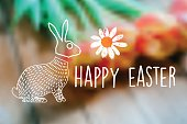 line art easter bunny on blurred wooden spring background