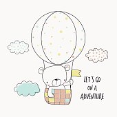 Little bear in a hot air balloon. Cartoon vector illustration for kids. T-shirt graphic for kid's clothing. Use for print design, surface design, fashion kids wear