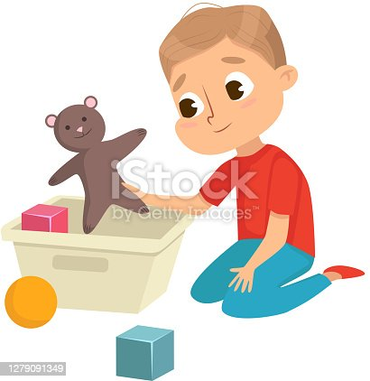 istock Little Big-eyed Boy Picking up Toys in Box Vector Illustration 1279091349