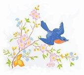 Little bird in flight in a flower bush