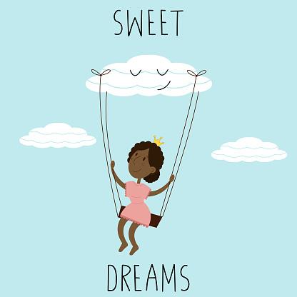little black skinned girl sitting on a swing