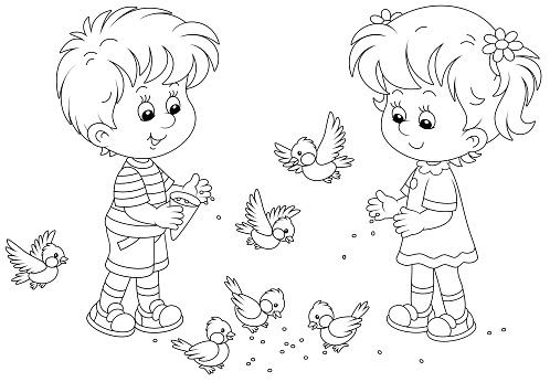 Little Boy and girl feeding small birds