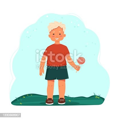 istock Little boy in shorts and a T-shirt holding a lollipop. Child with candy in hand. Vector cartoon character. Flat design 1330668907