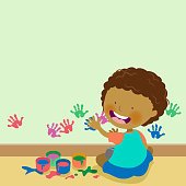 Little boy enjoy painting with hand