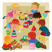 Little boys and girls sitting on the floor playing with