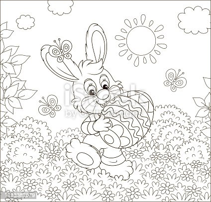 Friendly smiling little rabbit walking with a painted Easter egg among flowers on sunny spring day, black and white vector illustration in a cartoon style for a coloring book