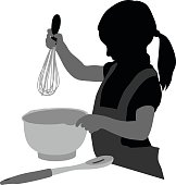 A vector silhouette illustration of a young girl cooking.  She holds a beather over a bowl while wearing and apron and pony tail with a slotted spoon on the coutner next to the bowl.