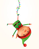 Little elf hanging upside down. Isolated.