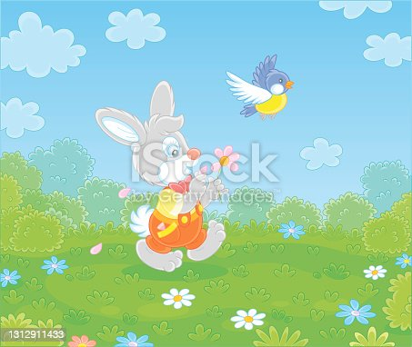 istock Little enamored bunny guessing on a daisy 1312911433