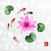 Little fishes and lotus flowers hand drawn with ink. Traditional oriental ink painting sumi-e, u-sin, go-hua. Contains hieroglyph - beauty