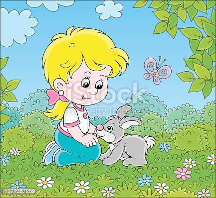 istock Little girl and her small rabbit 1272357259