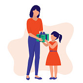 Happy Mother Receiving Gift From Her Daughter.