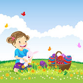 Little girl holding toy rabbit to enjoying the nature at Easter.