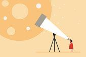 Little girl looks stars through a telescope