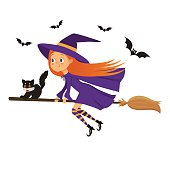 Little girl witch with a kitten flying on a broom