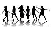 Group of little girls in expressive silhouette poses
