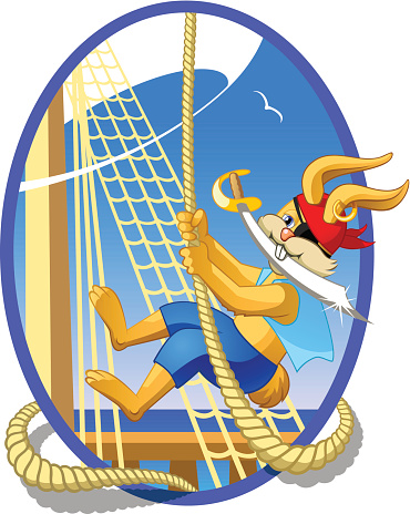 Little pirate swinging on a rope on a sailing ship