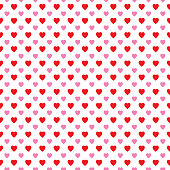 Vector seamless pattern of little red and pink hearts on a white background.