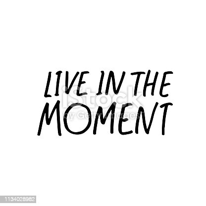 Live in the moment phrase. Hand drawn brush style modern calligraphy. Vectorillustration of handwritten lettering.