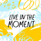 Live in the moment quote handwritten lettering. Vector ink modern calligraphy. Dry paint brushstrokes color background.