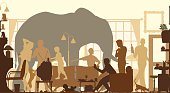 Editable vector silhouettes of an elephant standing in a living room during a family gathering
