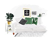 Living room interior with grey sofa,  green pillows and ficus plant.