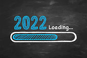 istock Loading New Year 2022 on Blackboard Background 1344633579