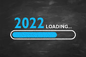 istock Loading New Year 2022 on Blackboard Background 1345874788