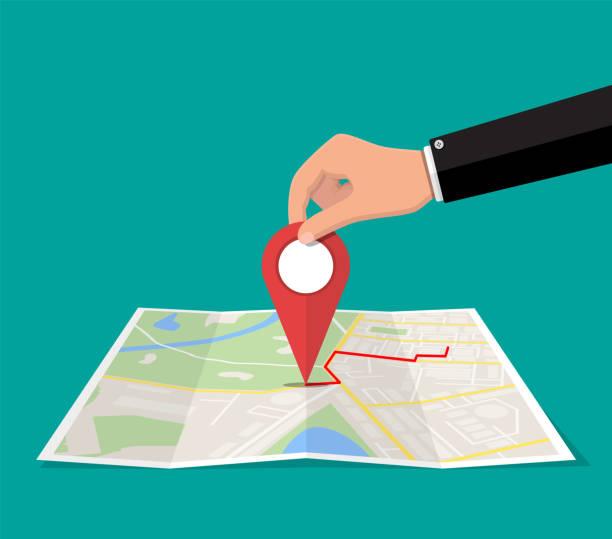 Positionsstift in der Hand und Papierkarte. – Vektorgrafik