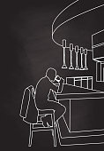 Blackboard business man sitting and drinking at a hotel bar