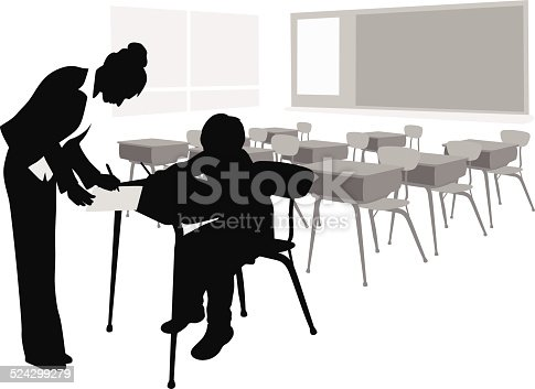 A female teacher offers special attention to a student after class.
