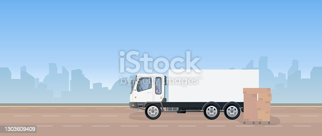 istock Lorry and pallet with boxes. A truck is standing on the road. Carton boxes. The concept of delivery and loading of cargo. Vector. 1303609409