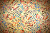 istock A lot of colorful International travel visa rubber stamps imprints on old paper, horizontal vintage background 818849472