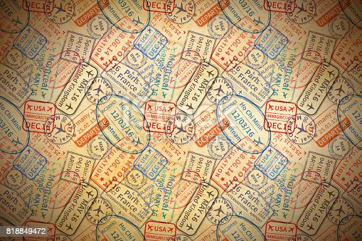 istock A lot of colorful International travel visa rubber stamps imprints on old paper, horizontal vintage background 818849472