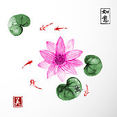 Lotus flowers and little fishes in pond isolated on white background. Traditional Japanese ink painting sumi-e. Contains hieroglyphs - dreams come true, beauty