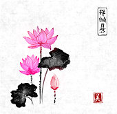 Lotus flowers hand drawn with ink on rice paper background. Traditional Japanese ink painting sumi-e. Contains hieroglyphs - zen, freedom, nature, beauty
